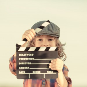 Kid holding clapper board in hands